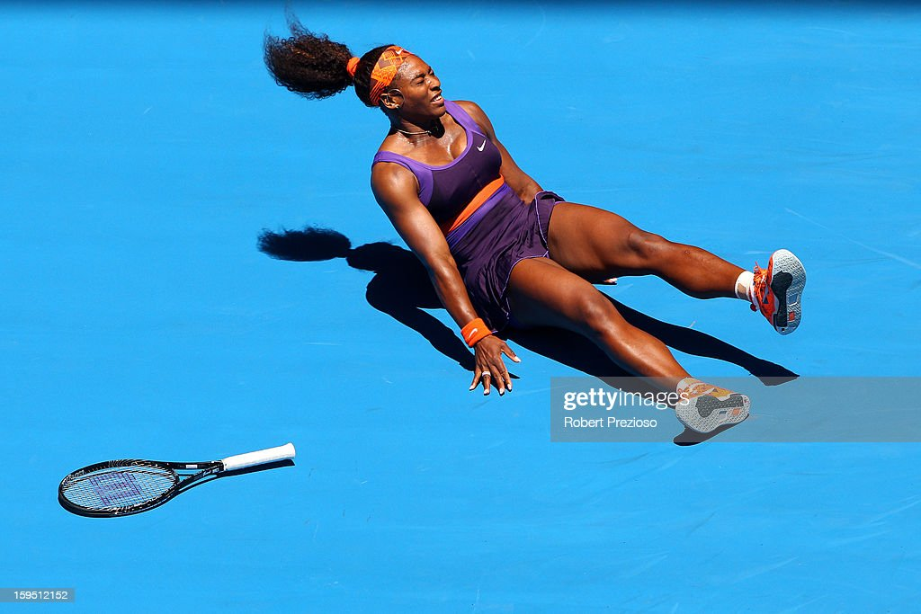 <a gi-track='captionPersonalityLinkClicked' href=/galleries/search?phrase=Serena+Williams&family=editorial&specificpeople=171101 ng-click='$event.stopPropagation()'>Serena Williams</a> of the United States falls onto the court injuring her ankle in her first round match against Edina Gallovits-Hall of Romania during day two of the 2013 Australian Open at Melbourne Park on January 15, 2013 in Melbourne, Australia.