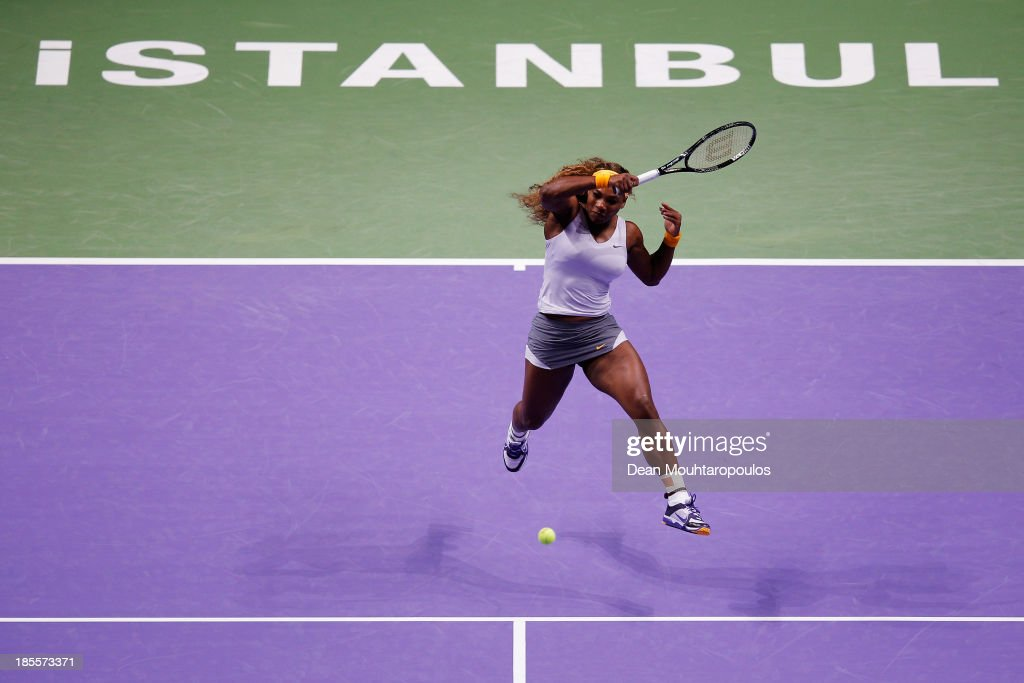 <a gi-track='captionPersonalityLinkClicked' href=/galleries/search?phrase=Serena+Williams&family=editorial&specificpeople=171101 ng-click='$event.stopPropagation()'>Serena Williams</a> of the United States hits a forehand to Angelique Kerber of Germany during day one of the TEB BNP Paribas WTA Championships at the Sinan Erdem Dome October 22, 2013 in Istanbul, Turkey.