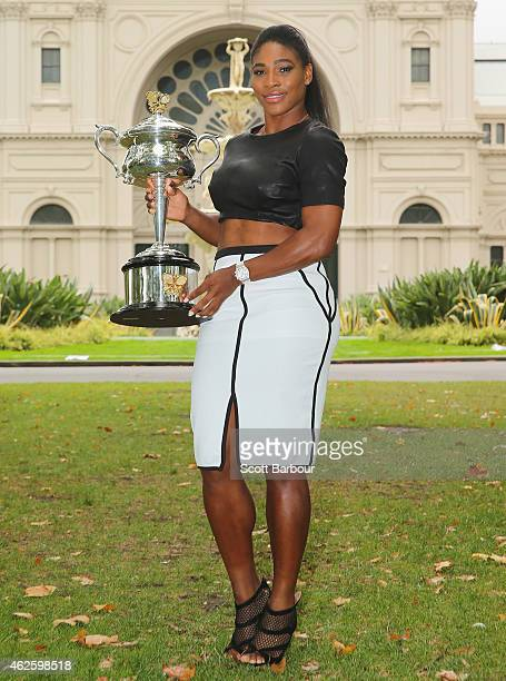 Serena Williams of the United States holds the Daphne Akhurst Memorial Cup during a photocall at the Royal Exhibition Building in Carlton Gardens...