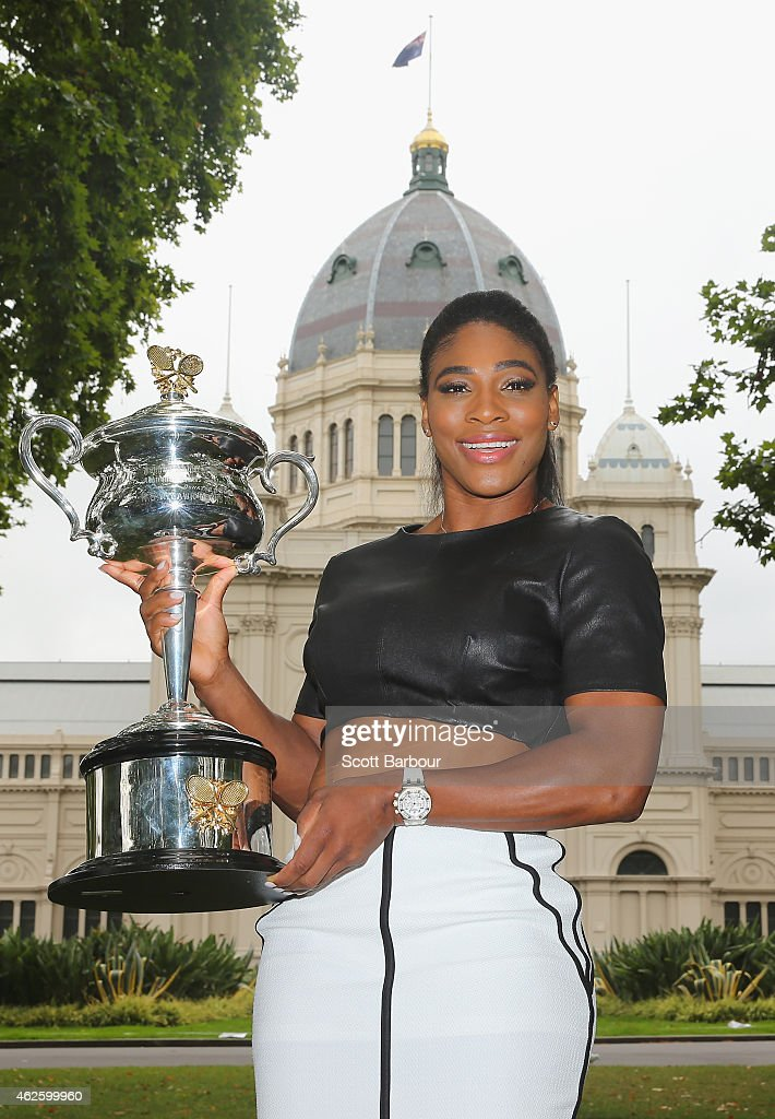 Serena Williams of the United States holds the Daphne Akhurst Memorial Cup during a photocall at the Royal Exhibition Building in Carlton Gardens after winning the 2015 Australian Open on February 1, 2015 in Melbourne, Australia.