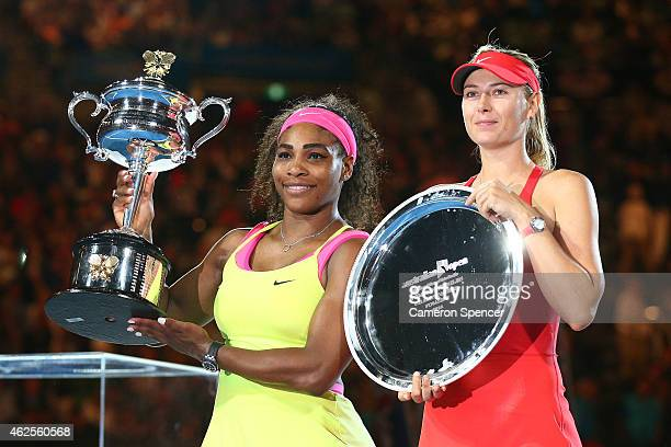 Serena Williams of the United States holds the Daphne Akhurst Memorial Cup and Maria Sharapova of Russia holds the runner up plate after their...