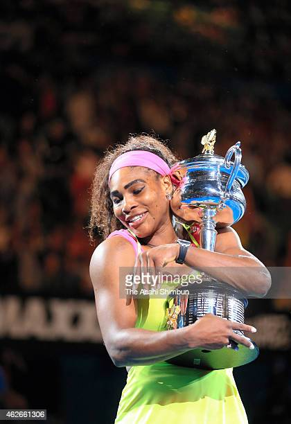 Serena Williams of the United States holds the Daphne Akhurst Memorial Cup after winning the women's final match against Maria Sharapova of Russia...