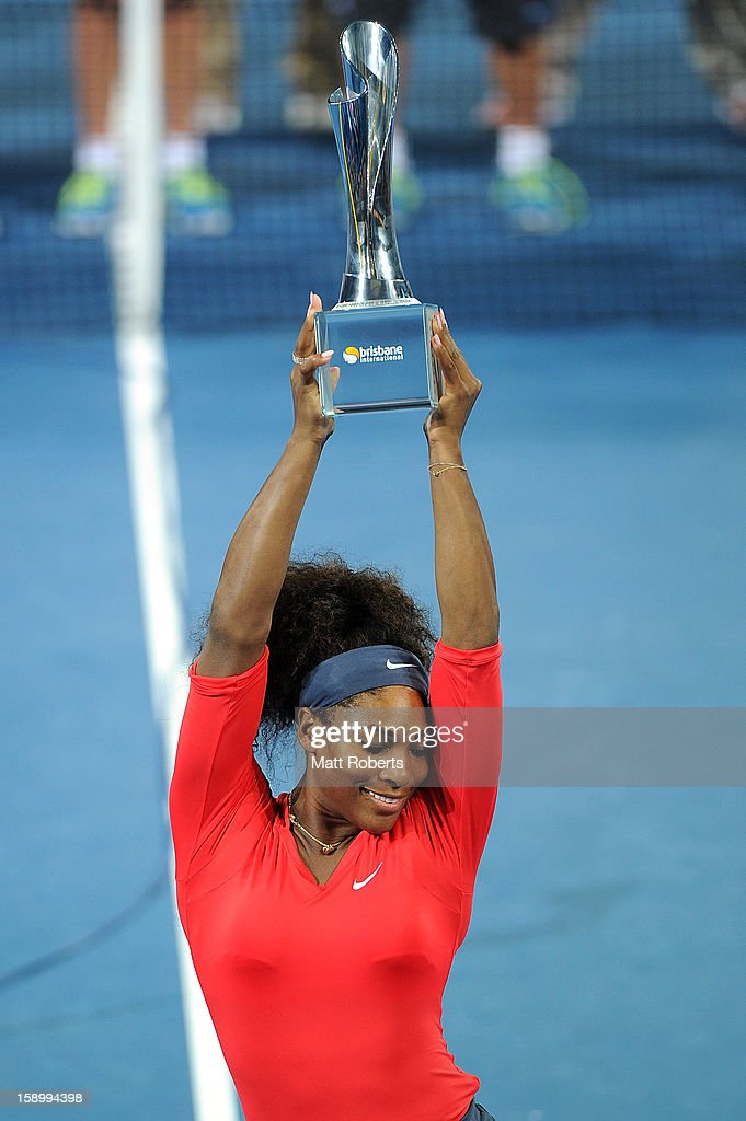 <a gi-track='captionPersonalityLinkClicked' href=/galleries/search?phrase=Serena+Williams&family=editorial&specificpeople=171101 ng-click='$event.stopPropagation()'>Serena Williams</a> of the United States holds the trophy aloft after winning the the final against Anastasia Pavlyuchenkova of Russia on day seven of the Brisbane International at Pat Rafter Arena on January 5, 2013 in Brisbane, Australia.
