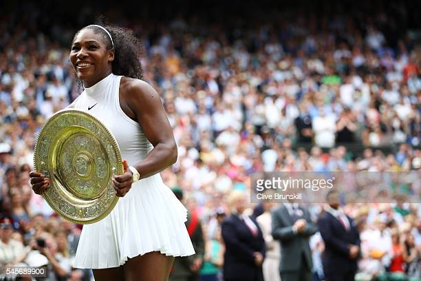 Serena Williams of The United States holds the trophy following victory in The Ladies Singles Final against Angelique Kerber of Germany on day twelve...