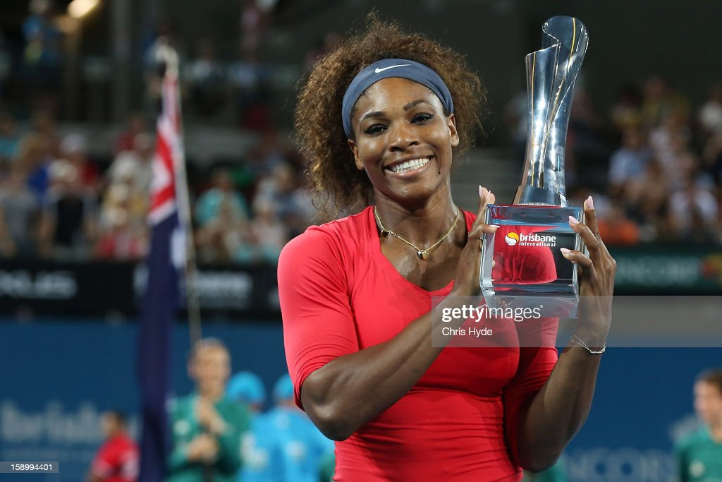 Serena Williams of the United States holds the winners trophy after winning her final match against Anastasia Pavlyuchenkova of Russia on day seven of the Brisbane International at Pat Rafter Arena on January 5, 2013 in Brisbane, Australia.
