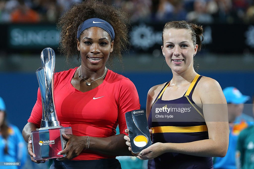 Serena Williams of the United States holds the winners trophy while her opponent Anastasia Pavlyuchenkova of Russia holds the runner up trophy after the womens final on day seven of the Brisbane International at Pat Rafter Arena on January 5, 2013 in Brisbane, Australia.