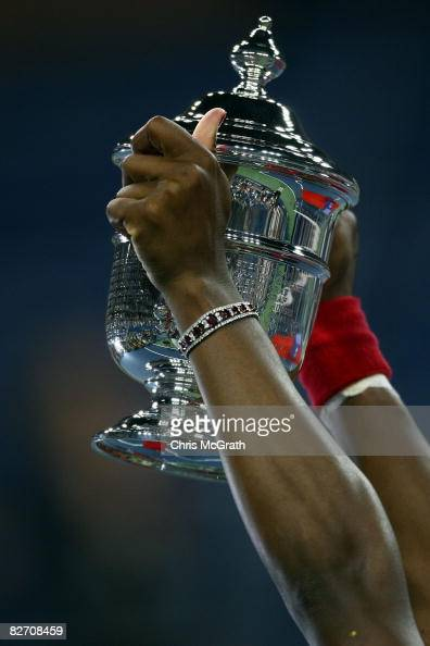 Serena Williams of the United States holds up the championship trophy after defeating Jelena Jankovic of Serbia in the women's singles finals on Day...