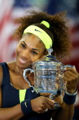 Serena Williams of the United States hugs the championship trophy after defeating Victoria Azarenka of Belarus to win the women's singles final match...