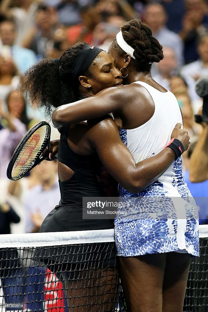 Serena Williams of the United States hugs Venus Williams of the United States after defeating her during their Women's Singles Quarterfinals match on...