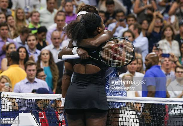 Serena Williams of the United States hugs Venus Williams of the United States after defeating her in their Women's Singles Quarterfinals match on Day...