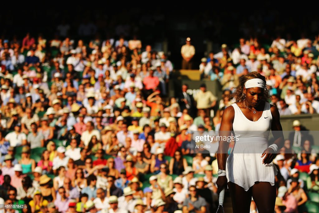 Serena Williams of the United States in action during her Ladies' Singles first round match against Anna Tatishvili of the United States on day two of the Wimbledon Lawn Tennis Championships at the All England Lawn Tennis and Croquet Club at Wimbledon on June 24, 2014 in London, England.