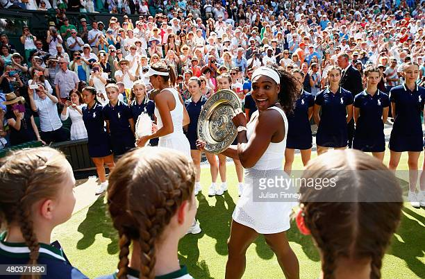 Serena Williams of the United States leaves court with the Venus Rosewater Dish after her victory in the Final Of The Ladies' Singles against Garbine...