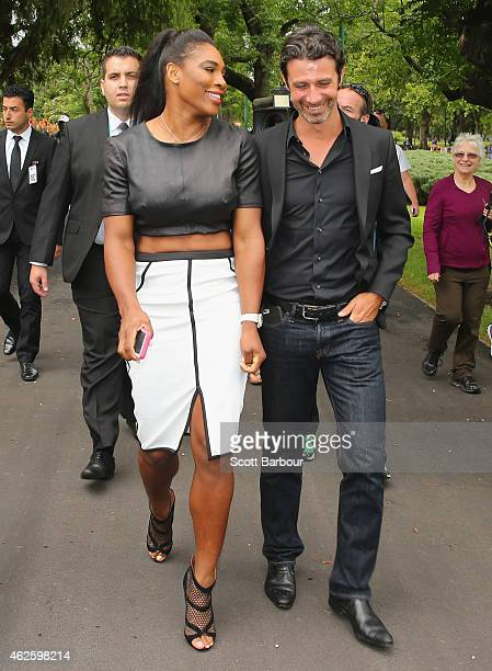 Serena Williams of the United States leaves with her partner and coach Patrick Mouratoglou and the Daphne Akhurst Memorial Cup after a photocall at...
