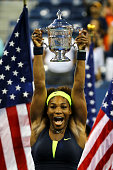 Serena Williams of the United States lifts the championship trophy after defeating Victoria Azarenka of Belarus to win the women's singles final...