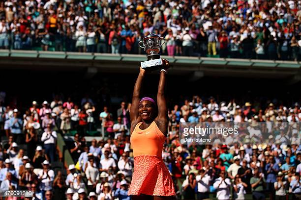 Serena Williams of the United States lifts the Coupe Suzanne Lenglen trophy after winning the Women's Singles Final against Lucie Safarova of Czech...