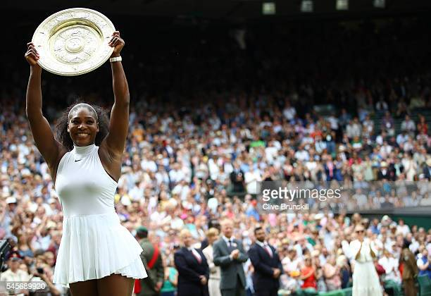 Serena Williams of The United States lifts the trophy following victory in The Ladies Singles Final against Angelique Kerber of Germany on day twelve...