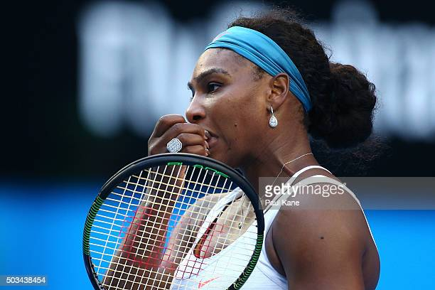 Serena Williams of the United States looks on during her singles match against Jarmila Wolfe of Australia Gold with a knee in jury during day three...