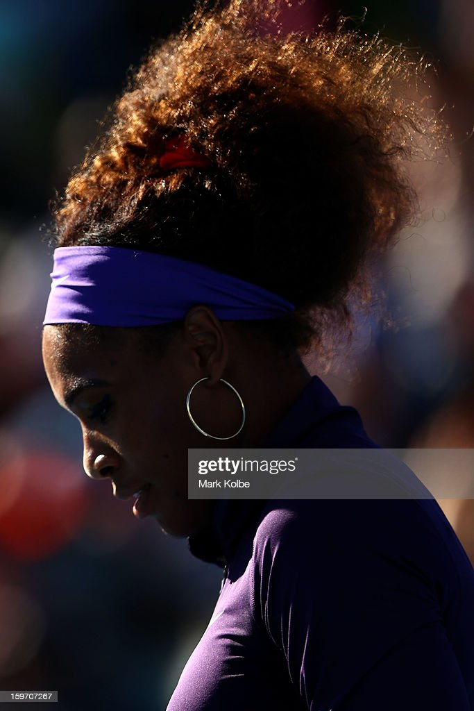 Serena Williams of the United States looks on in her second round doubles match with Venus Williams of the United States against Vera Dushevina of Russia and Olga Govortsova of Belarus during day six of the 2013 Australian Open at Melbourne Park on January 19, 2013 in Melbourne, Australia.