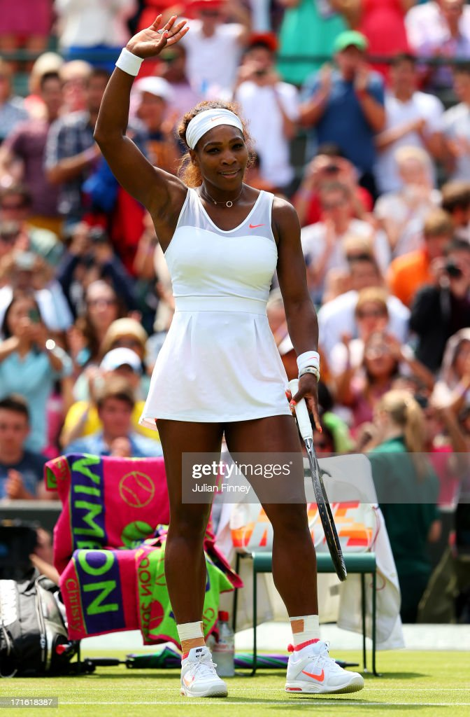 <a gi-track='captionPersonalityLinkClicked' href=/galleries/search?phrase=Serena+Williams&family=editorial&specificpeople=171101 ng-click='$event.stopPropagation()'>Serena Williams</a> of the United States of America celebrates match point during the Ladies' Singles second round match against Caroline Garcia of France on day four of the Wimbledon Lawn Tennis Championships at the All England Lawn Tennis and Croquet Club on June 27, 2013 in London, England.
