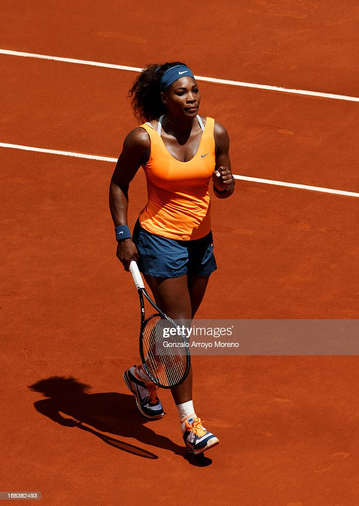 Serena Williams of the United States of America celebrates matchpoint over Maria Kirilenko of Russia on day six of the Mutua Madrid Open tennis tournament at the Caja Magica on May 9, 2013 in Madrid, Spain.