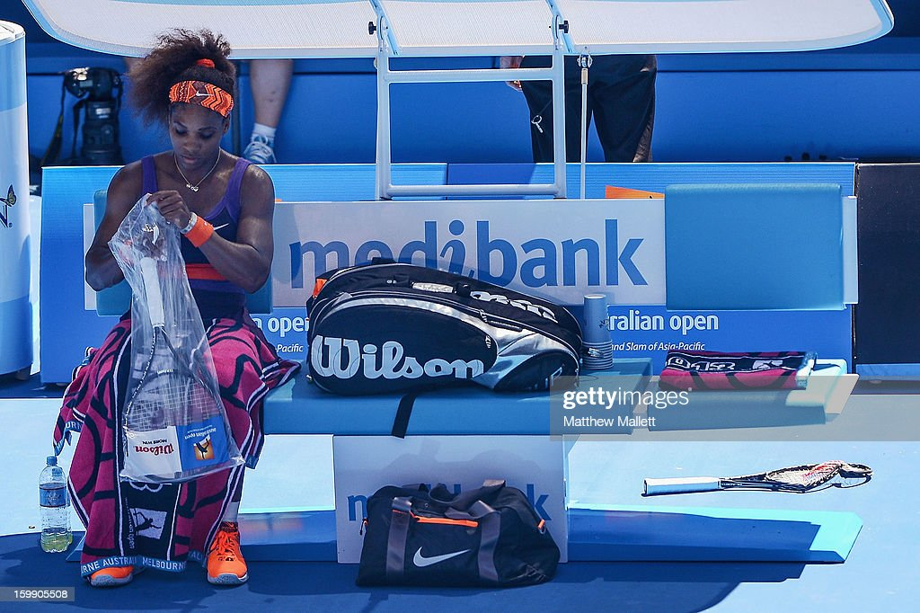 Serena Williams of the United States of America looks on during a break between games in her Quarterfinal match against Sloane Stephens of the United States of America during day ten of the 2013 Australian Open at Melbourne Park on January 23, 2013 in Melbourne, Australia.