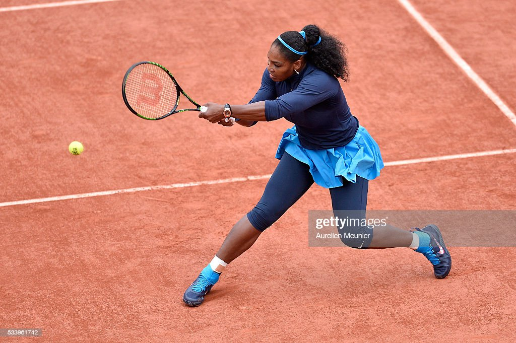 Serena Williams of The United States Of America plays a backhand during her women's single first round match against Magdelena Rybarikova of Slovakia at Roland Garros on May 24, 2016 in Paris, France.