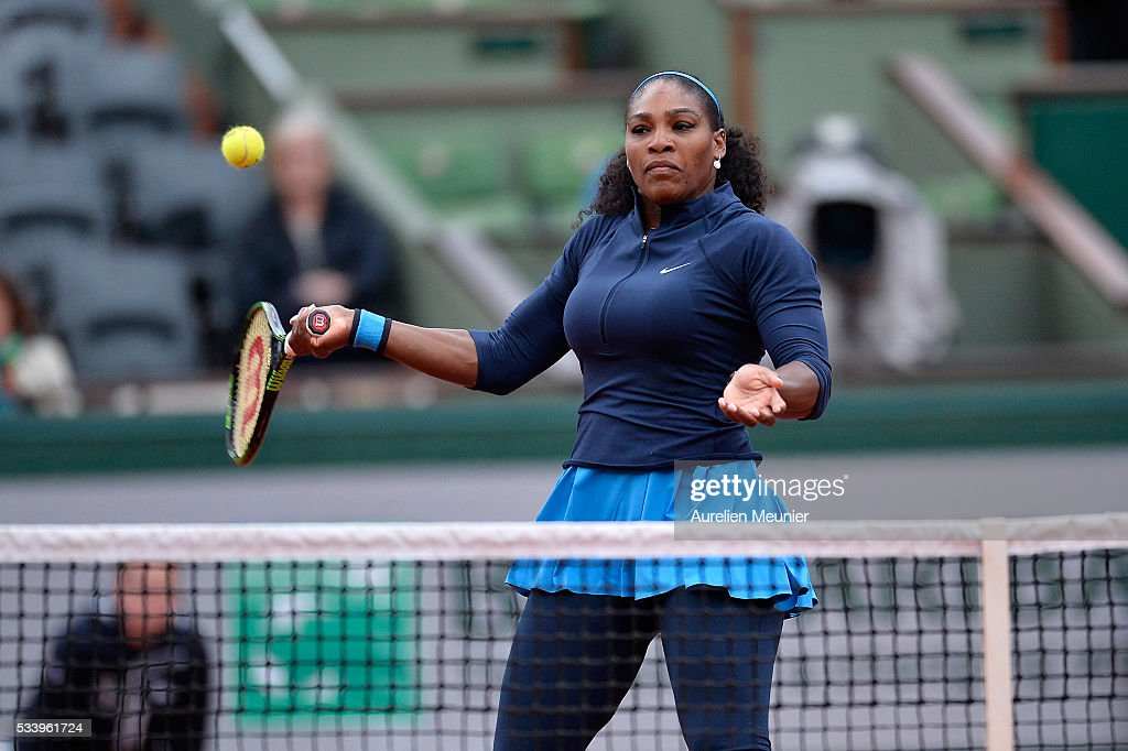 Serena Williams of The United States Of America plays a forehand during her women's single first round match against Magdelena Rybarikova of Slovakia at Roland Garros on May 24, 2016 in Paris, France.