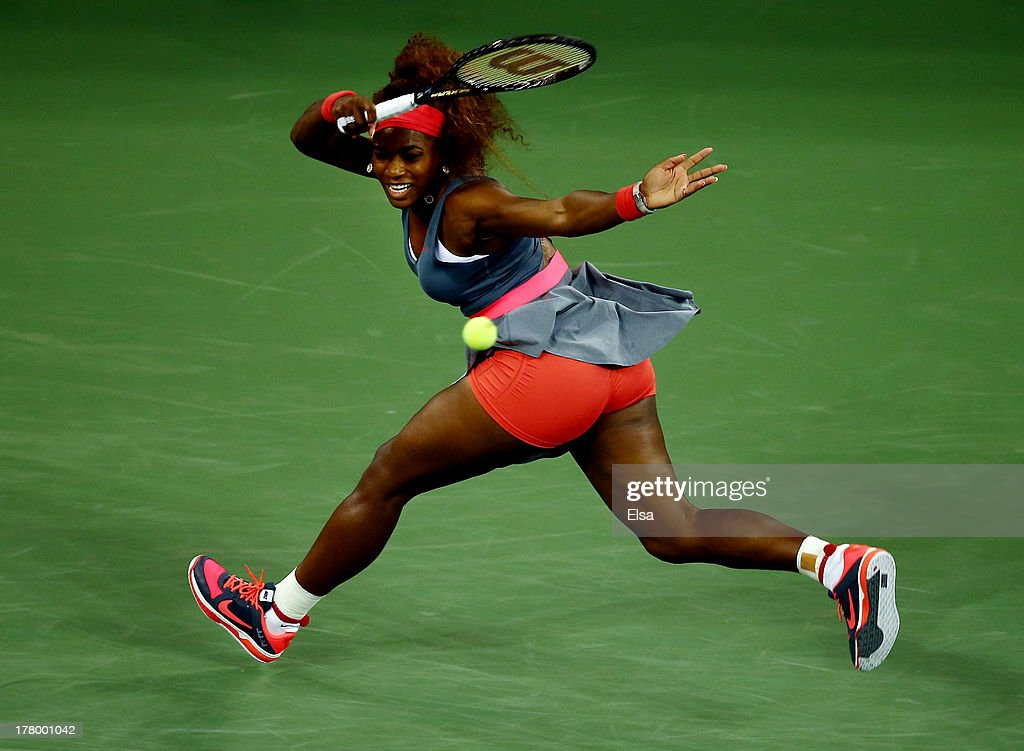 <a gi-track='captionPersonalityLinkClicked' href=/galleries/search?phrase=Serena+Williams+-+Tennis+Player&family=editorial&specificpeople=171101 ng-click='$event.stopPropagation()'>Serena Williams</a> of the United States of America plays a forehand against Francesca Schiavone of Italy during their women's singles first round match on Day One of the 2013 US Open at USTA Billie Jean King National Tennis Center on August 26, 2013 in the Flushing neighborhood of the Queens borough of New York City.