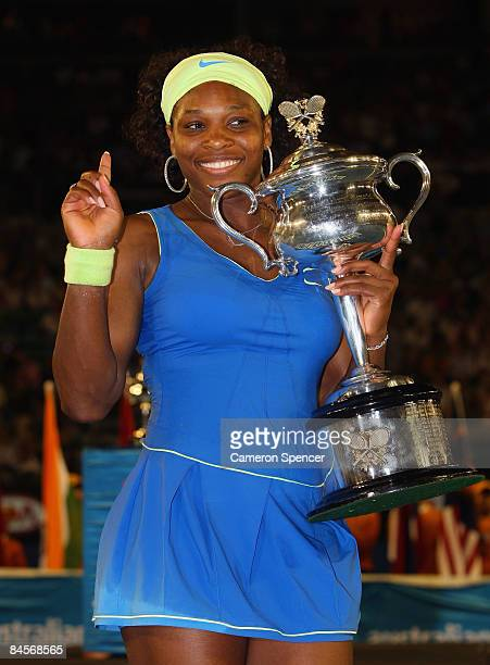 Serena Williams of the United States of America poses with the Daphne Akhurst Trophy after winning the women's final match against Dinara Safina of...