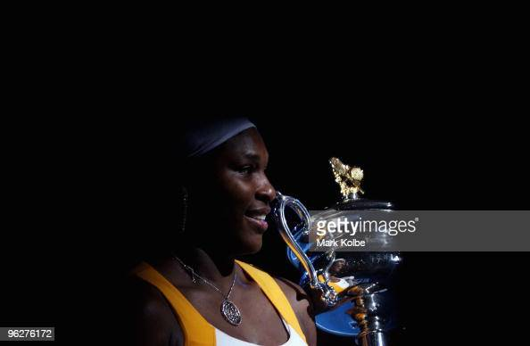Serena Williams of the United States of America poses with the Daphne Akhurst Trophy after winning her women's final match against Justine Henin of...