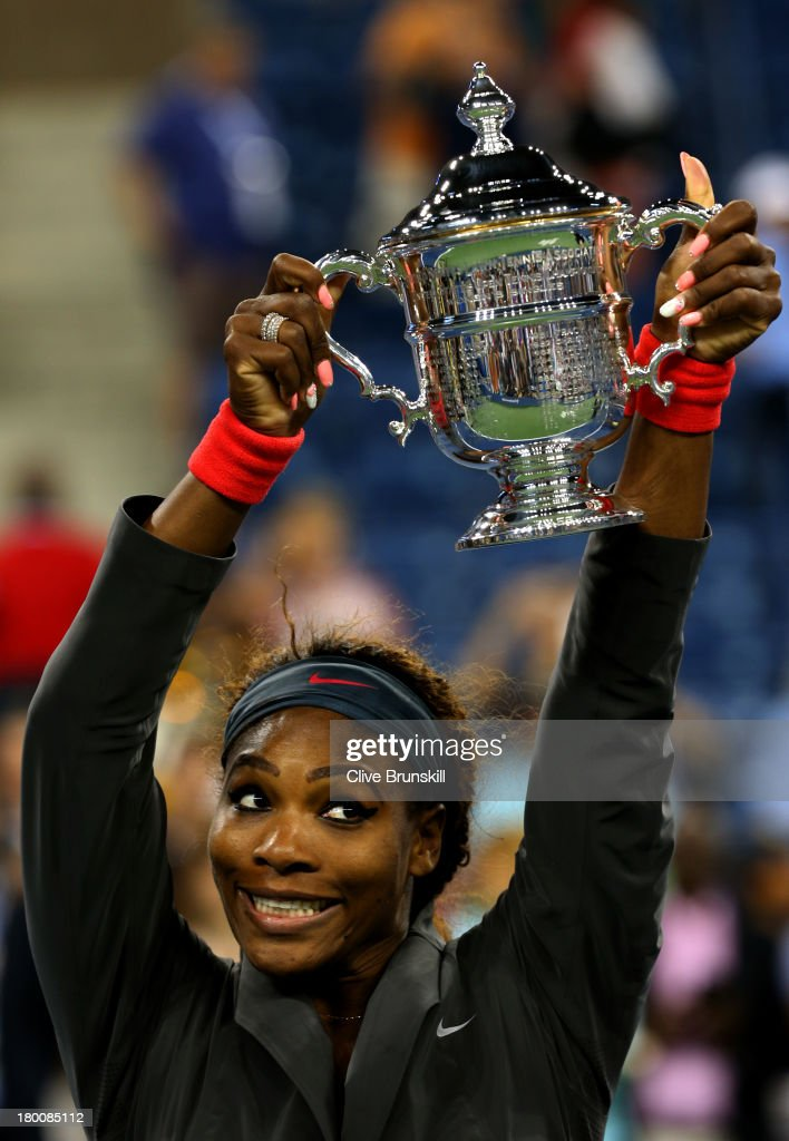 <a gi-track='captionPersonalityLinkClicked' href=/galleries/search?phrase=Serena+Williams+-+Tennis+Player&family=editorial&specificpeople=171101 ng-click='$event.stopPropagation()'>Serena Williams</a> of the United States of America poses with the trophy after winning her women's singles final match against <a gi-track='captionPersonalityLinkClicked' href=/galleries/search?phrase=Victoria+Azarenka&family=editorial&specificpeople=604872 ng-click='$event.stopPropagation()'>Victoria Azarenka</a> of Belarus on Day Fourteen of the 2013 US Open at the USTA Billie Jean King National Tennis Center on September 8, 2013 in the Flushing neighborhood of the Queens borough of New York City.