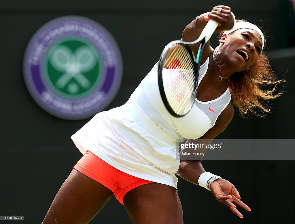 <a gi-track='captionPersonalityLinkClicked' href=/galleries/search?phrase=Serena+Williams&family=editorial&specificpeople=171101 ng-click='$event.stopPropagation()'>Serena Williams</a> of the United States of America serves during the Ladies' Singles second round match against Caroline Garcia of France on day four of the Wimbledon Lawn Tennis Championships at the All England Lawn Tennis and Croquet Club on June 27, 2013 in London, England.