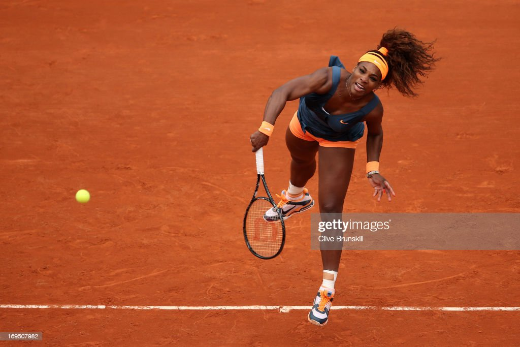 Serena Williams of the United States of America serves in her Women's Singles match against Anna Tatishvili of Georgia during day one of the French Open at Roland Garros on May 26, 2013 in Paris, France.
