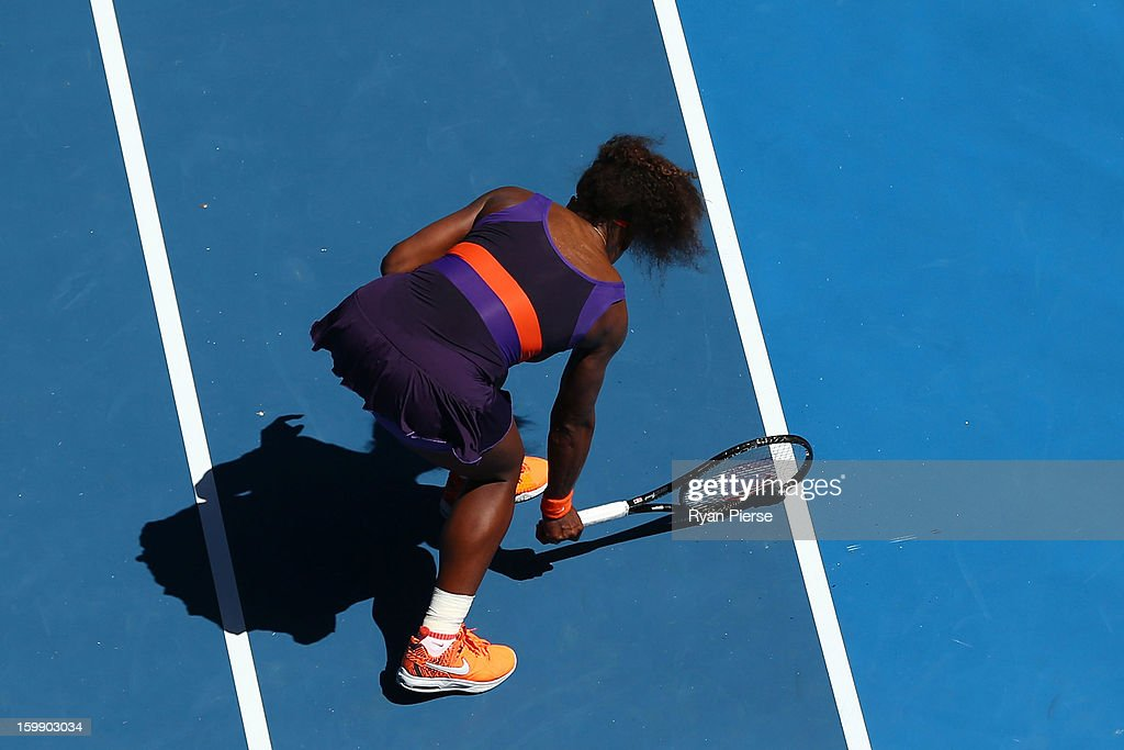 Serena Williams of the United States of America smashes her racquet as she walks to her chair between games in her Quarterfinal match against Sloane Stephens of the United States of America during day ten of the 2013 Australian Open at Melbourne Park on January 23, 2013 in Melbourne, Australia.