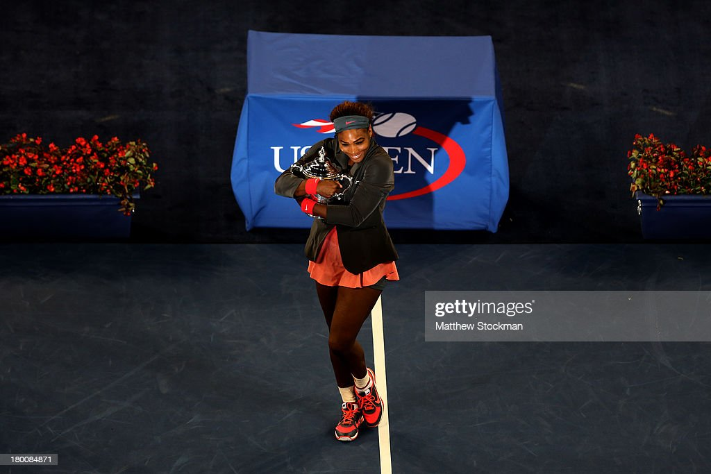 <a gi-track='captionPersonalityLinkClicked' href=/galleries/search?phrase=Serena+Williams+-+Tennis+Player&family=editorial&specificpeople=171101 ng-click='$event.stopPropagation()'>Serena Williams</a> of the United States of America smiles as she poses with the trophy after winning her women's singles final match against Victoria Azarenka of Belarus on Day Fourteen of the 2013 US Open at the USTA Billie Jean King National Tennis Center on September 8, 2013 in the Flushing neighborhood of the Queens borough of New York City.