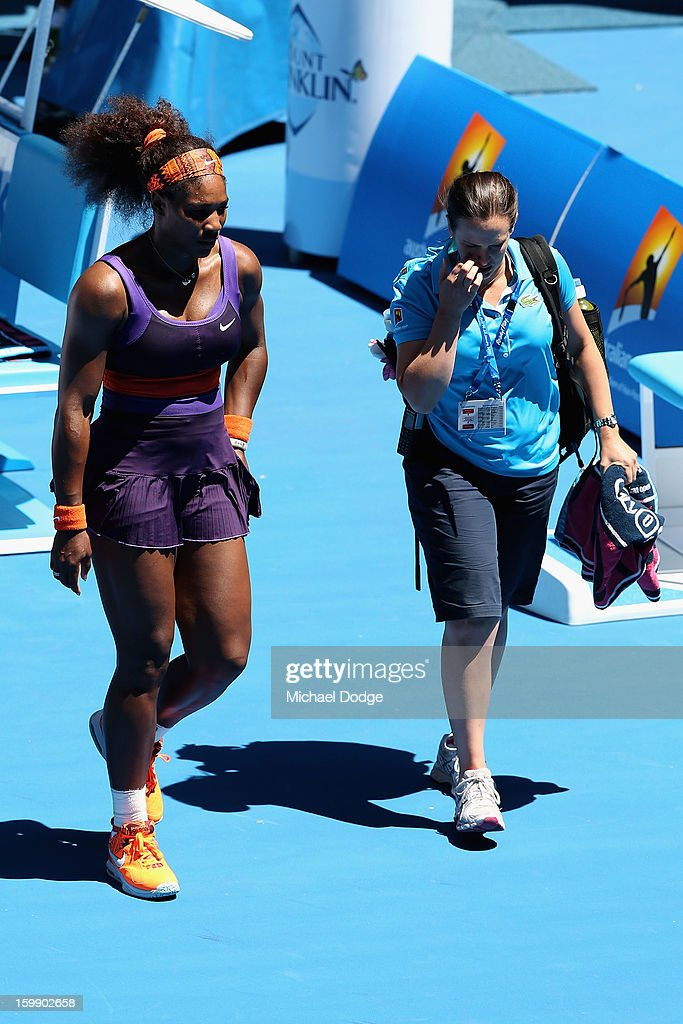Serena Williams of the United States of America walks off court for a injury time out in her Quarterfinal match against Sloane Stephens of the United States of America during day ten of the 2013 Australian Open at Melbourne Park on January 23, 2013 in Melbourne, Australia.