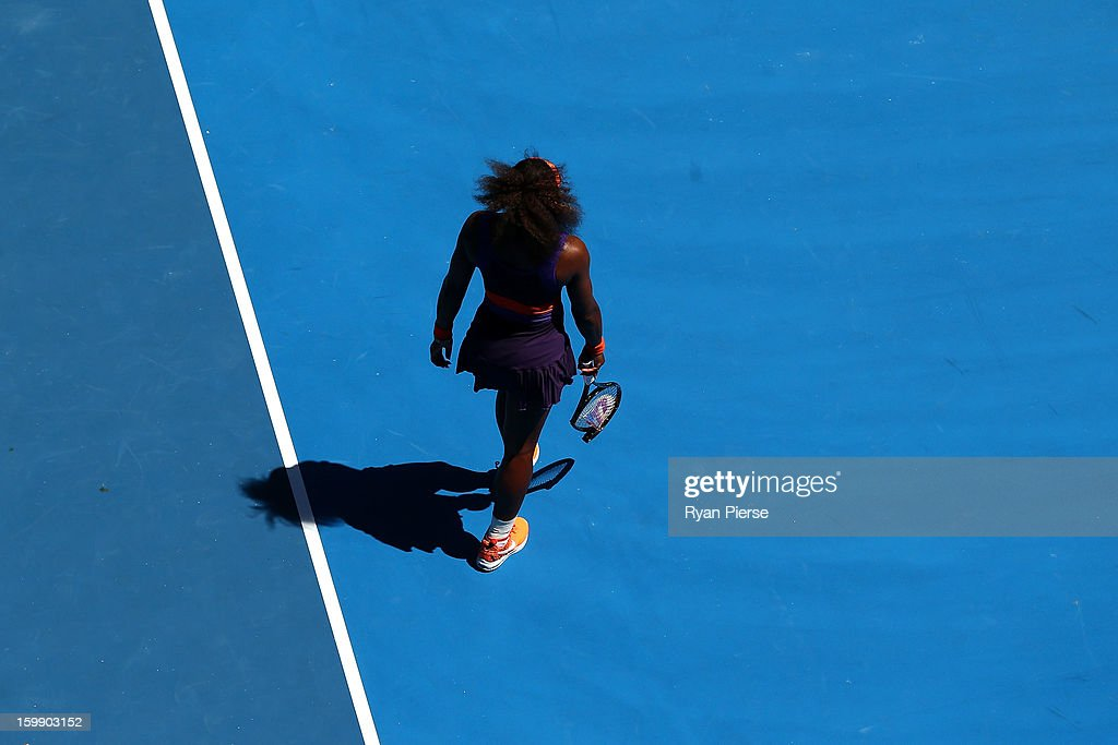 Serena Williams of the United States of America walks to her chair between points after smashing her racquet in her Quarterfinal match against Sloane Stephens of the United States of America during day ten of the 2013 Australian Open at Melbourne Park on January 23, 2013 in Melbourne, Australia.