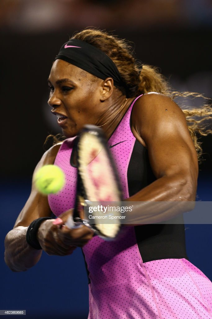 Serena Williams of the United States plays a backhand in her first round match against Ashleigh Barty of Australia during day one of the 2014 Australian Open at Melbourne Park on January 13, 2014 in Melbourne, Australia.