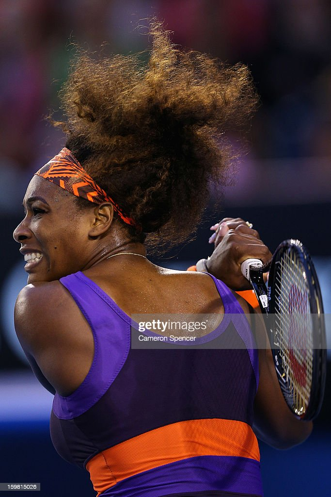 Serena Williams of the United States plays a backhand in her fourth round match against Maria Kirilenko of Russia during day eight of the 2013 Australian Open at Melbourne Park on January 21, 2013 in Melbourne, Australia.