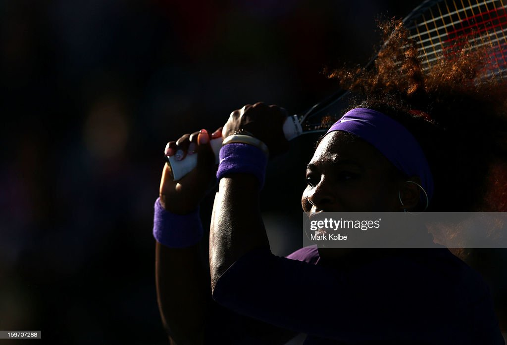 Serena Williams of the United States plays a backhand in her second round doubles match with Venus Williams of the United States against Vera Dushevina of Russia and Olga Govortsova of Belarus during day six of the 2013 Australian Open at Melbourne Park on January 19, 2013 in Melbourne, Australia.