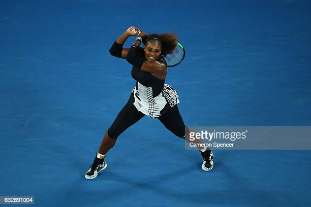 Serena Williams of the United States plays a backhand in her Women's Singles Final match against Venus Williams of the United States on day 13 of the...
