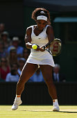 Serena Williams of the United States plays a backhand in the Ladies Singles Semi Final match against Maria Sharapova of Russia during day ten of the...
