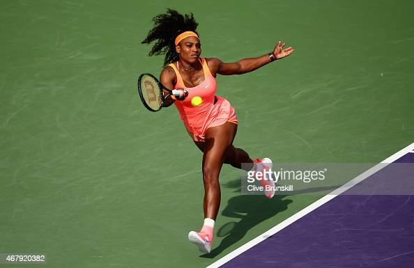 Serena Williams of the United States plays a forehand against Monica Niculescu of Romania in their second round match during the Miami Open Presented...