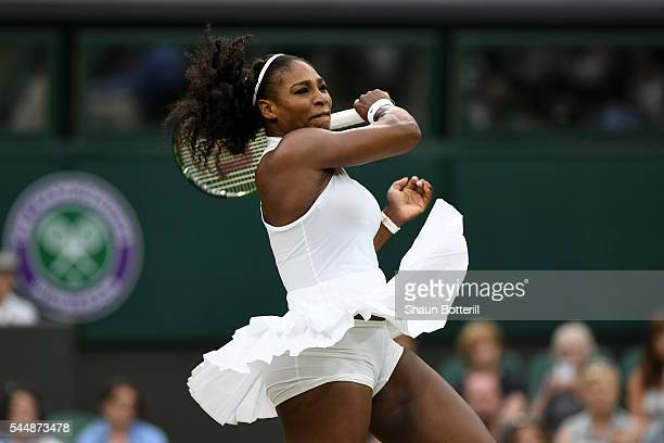 Serena Williams of The United States plays a forehand during the Ladies Singles fourth round match against Svetlana Kuznetsova of Russia on day seven...