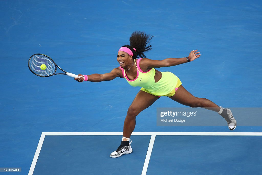 Serena Williams of the United States plays a forehand in her first round match against Alison Van Uytvanck of Belgium during day two of the 2015...