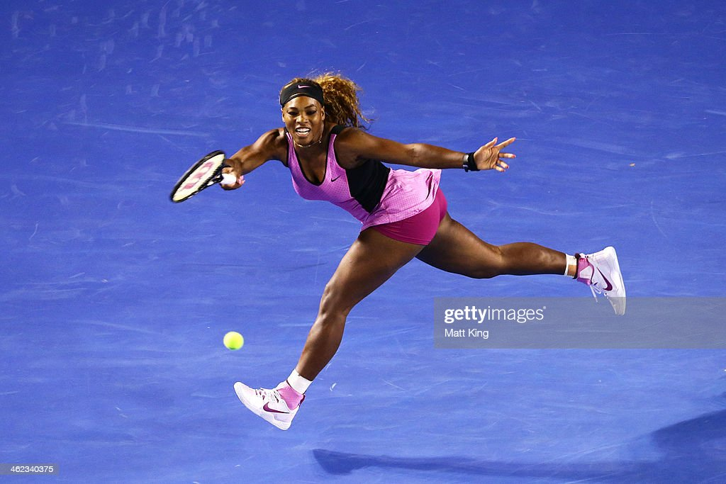 Serena Williams of the United States plays a forehand in her first round match against Ashleigh Barty of Australia during day one of the 2014 Australian Open at Melbourne Park on January 13, 2014 in Melbourne, Australia.