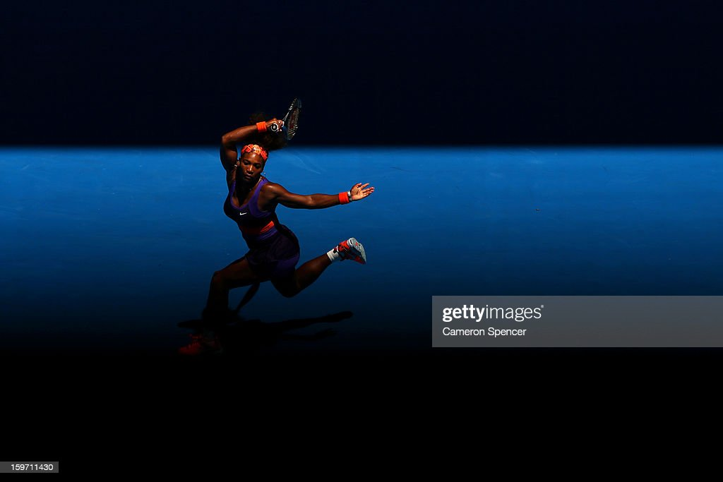 <a gi-track='captionPersonalityLinkClicked' href=/galleries/search?phrase=Serena+Williams+-+Tennis+Player&family=editorial&specificpeople=171101 ng-click='$event.stopPropagation()'>Serena Williams</a> of the United States plays a forehand in her third round match against Ayumi Morita of Japan during day six of the 2013 Australian Open at Melbourne Park on January 19, 2013 in Melbourne, Australia.