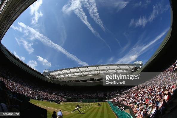 Serena Williams of the United States plays a forehand in the Final Of The Ladies' Singles against Garbine Muguruza of Spain during day twelve of the...
