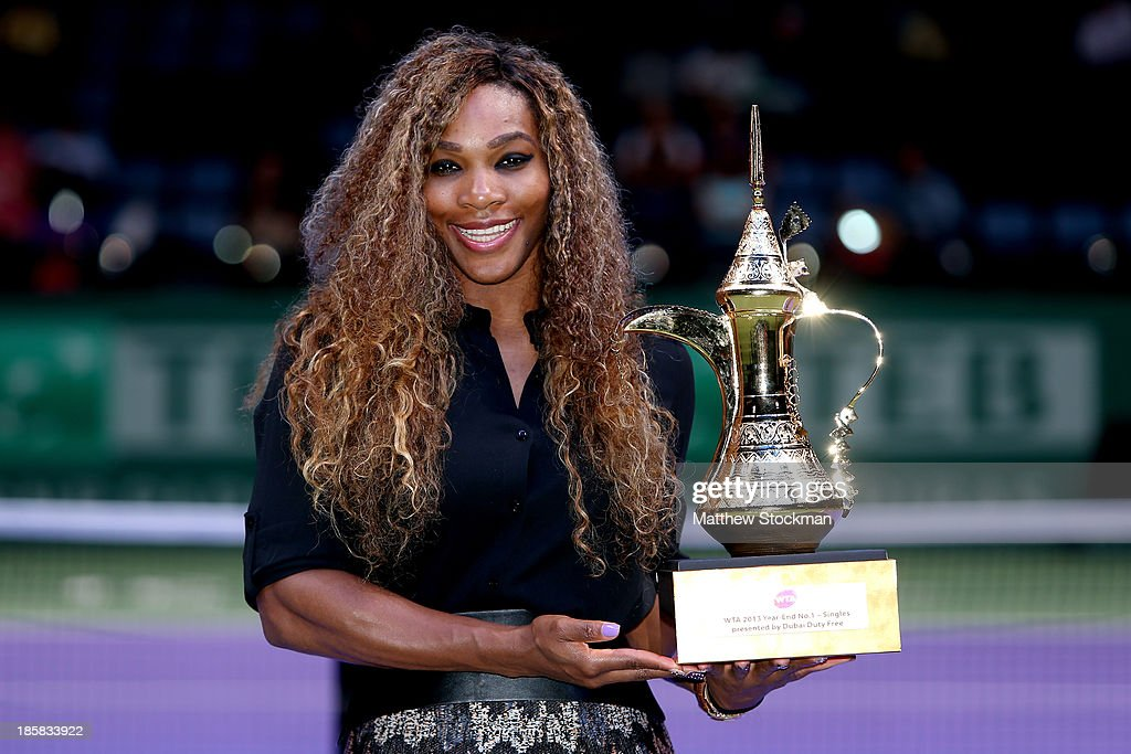 <a gi-track='captionPersonalityLinkClicked' href=/galleries/search?phrase=Serena+Williams&family=editorial&specificpeople=171101 ng-click='$event.stopPropagation()'>Serena Williams</a> of the United States poses for photographers after receiving the WTA Year End No. 1 Singles presented by Dubai Duty Free trophy during day four of the TEB BNP Paribas WTA Championships at the Sinan Erdem Dome on October 25, 2013 in Istanbul, Turkey.