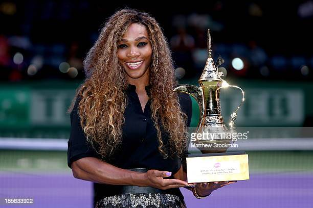 Serena Williams of the United States poses for photographers after receiving the WTA Year End No 1 Singles presented by Dubai Duty Free trophy during...